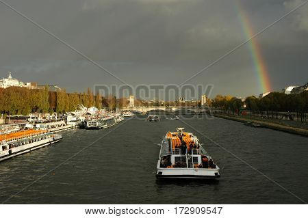 Paris, France - 3 November 2002: rainbow on over river Seine at Paris on France