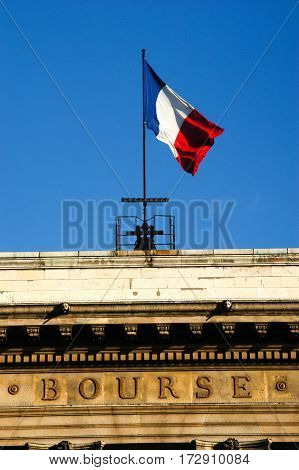 French flag on the stock exchange building at Paris