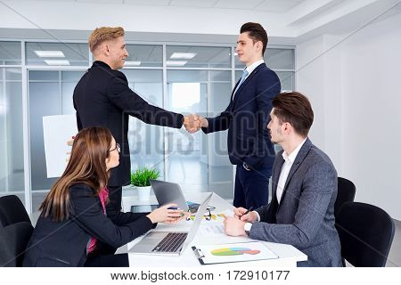 Handshake of business people in the office. Conclusion businessmen contract. Meeting partners.