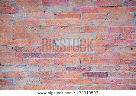Weathered stained old brick wall background, texture