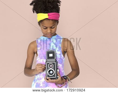 Little african girl holding camera