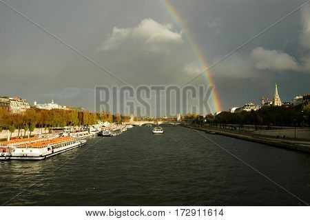 Rainbow On Over River Seine At Paris On France