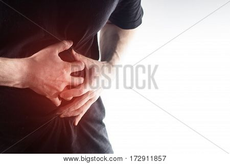 Man, Guy In A Black T Shirt On A White Background Hold Hands On His Stomach,  Liver Pain, Pancreas,