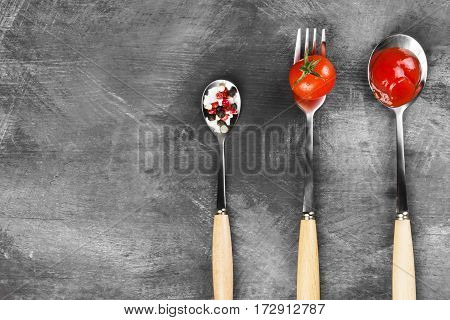 Tomato Sauce, Cherry, Spices In Fork And Spoons On A Dark Background. Top View, Copy Space. Food Bac