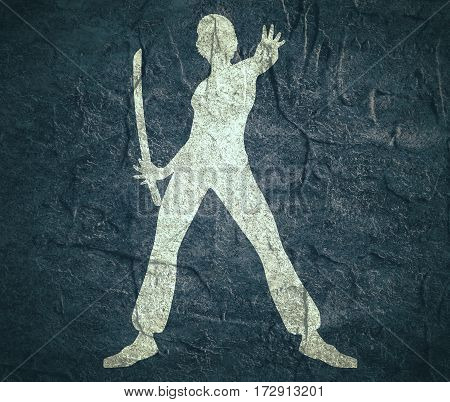 Karate martial art silhouette of woman in sword fight karate pose. Concrete textured.
