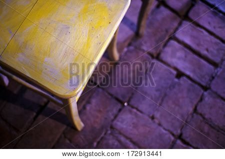 Wooden Chair On Brick Floor