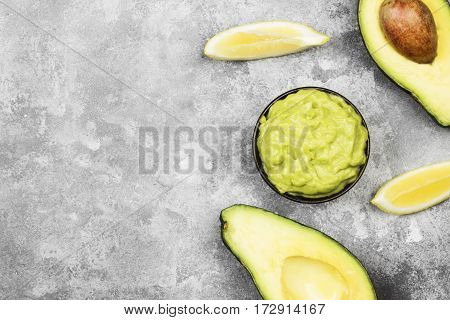 Traditional Latin American Sauce Guacamole In A Bowl And Ripe Avocados And Lemons. Top View, Copy Sp
