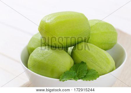 bowl of peeled kiwi - close up
