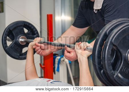 The Man Lifts A Bar In Gym.