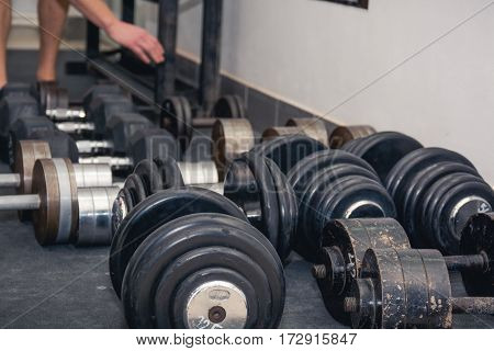 Several Dumbbell Lies On A Floor.