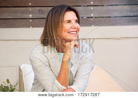 Attractive Woman Sitting Outside And Smiling