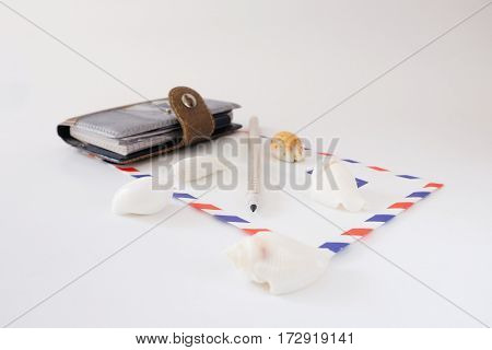 notebook envelope pencil on a white background isolated with white seashells