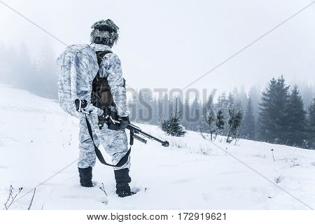 Winter arctic mountains warfare. Action in cold conditions. Sniper with weapons