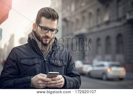 Man writing a text message