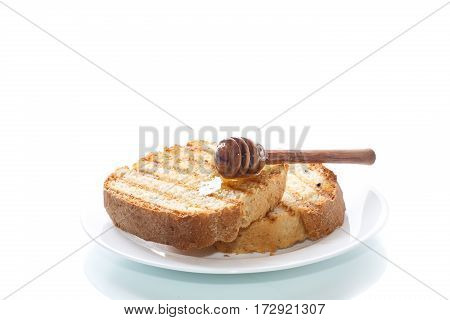 Fried toast with honey on a white background