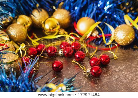 Colored Christmas toys on the table. Celebrate the New Year.