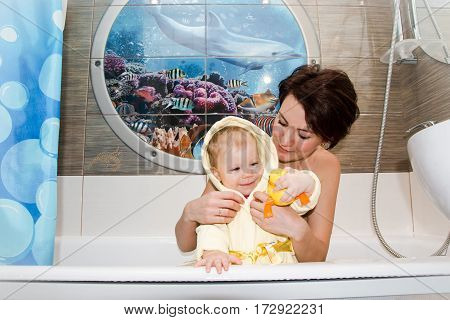 Pretty Mom And Cute Baby In A Bathroom