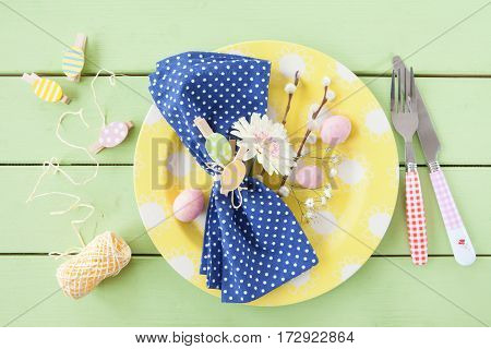 Colorful table setting with decorations for a happy easter