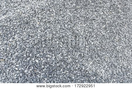 small grey crushed stones stack texture background