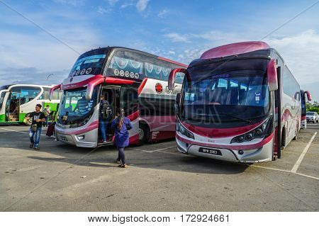 Menumbok,Sabah-Aug 19,2016:People running up to the bus in bus terminal at Menumbok,Sabah.People used to take bus from Kota Kinabalu to Menumbok then ferry to Labuan island to enjoy tax free shopping