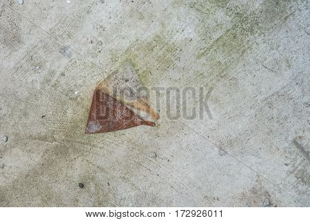 Photo of grey concrete wall with the rust metal tool for texture background.