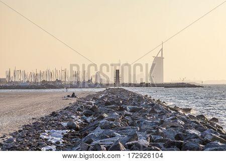 Public beach at the Persian Gulf coast and hotel Burj al Arab in Dubai. United Arab Emirates Middle East