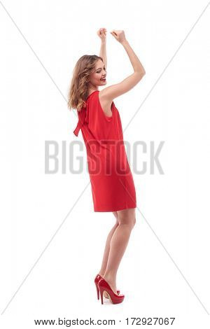 Full-length shot of woman dancing against white background. Gorgeous happy woman posing in the studio