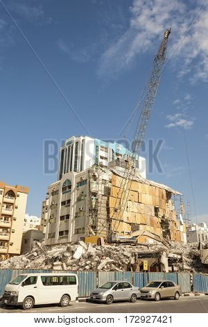 Demolition of an old residential building in the urban environment