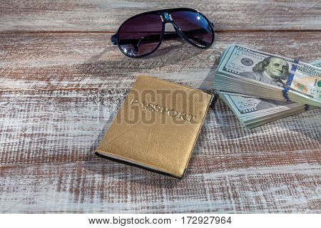 objects for travel isolated on a wooden background