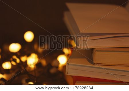 Close up view of books with defocused lights on background