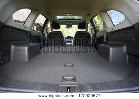 View of car passenger car luggage compartment with folding seats