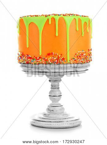 Vintage wooden stand with birthday cake isolated on white