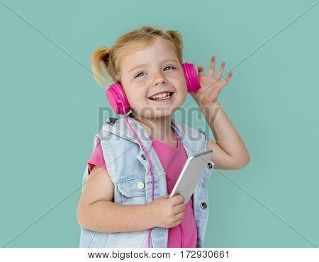Little GIrl Smiling Happiness Music Headphones