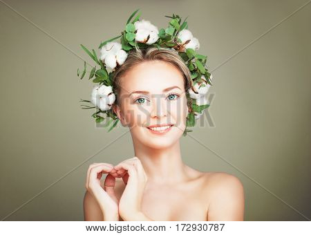 Spa Model Woman with Healthy Skin and Cotton Flowers Wreath making a Heart. Spa Beauty Facial Treatment and Cosmetology Concept