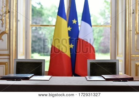 European Union and Romania flags during a treaty sign