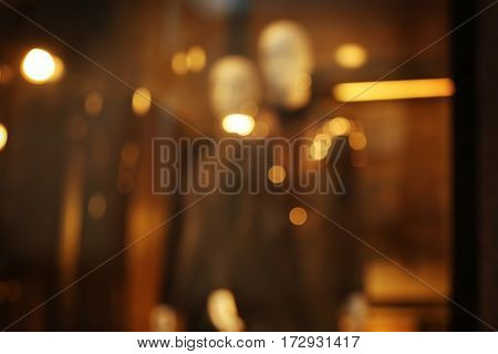 Blurred background of fashion store showcase with mannequins