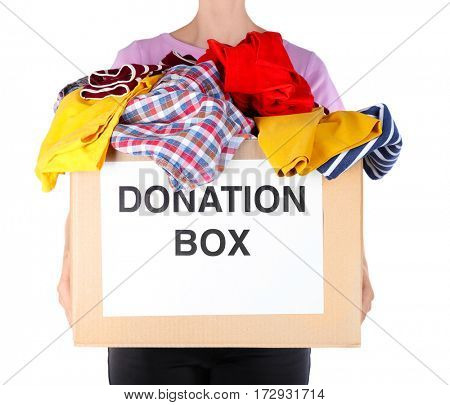 Woman holding donation box with clothes on white background