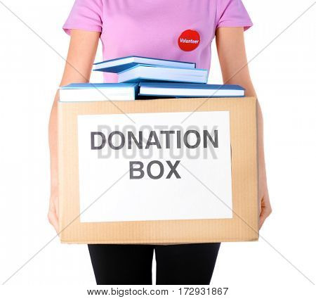Woman holding donation box with books on white background