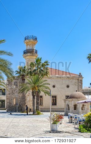 Turkish mosque and old fountain in the town of Lerapetra on the Greek island of Crete.