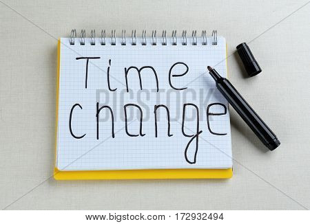 Phrase TIME CHANGE in notebook