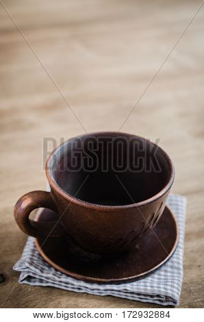 Empty Clay Cup on Wooden Background. Home Wares. Kitchen Decor in Rustic Style. View From Above With Copy Space.