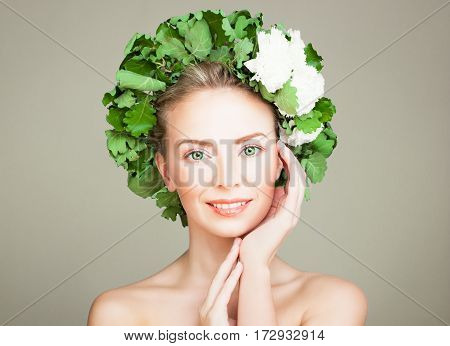 Healthy Woman with Clear Skin and Flowers Wreath. Happy Spa Model