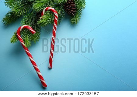 Christmas candy canes on light blue background
