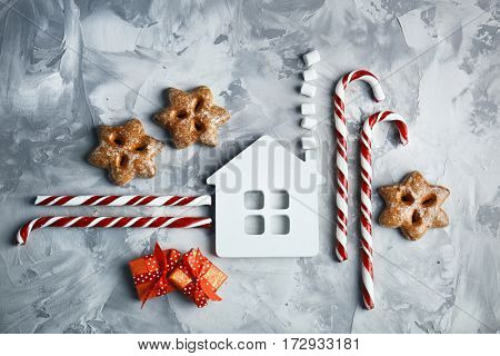 Christmas composition with candy canes and decorations on textured background