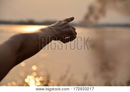 hand point forward symbol silhouette style under the sky