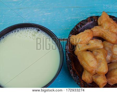 Close up Soy milk Placed on a wooden table green.
