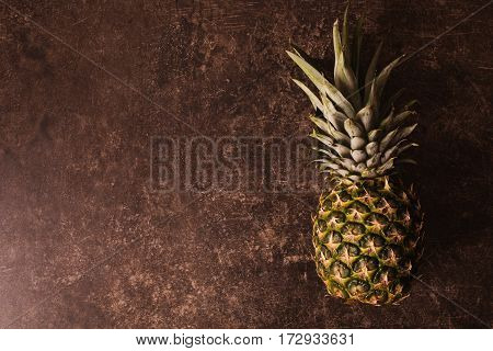 Ripe pineapple lying on a dark marble table. Delicious fruit. Healthy eating. Pineapple on the table
