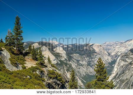 Tenaya Canyon is a dramatic and dangerous canyon in Yosemite National Park California USA that runs from the outlet of Tenaya Lake 10 miles down to Yosemite Valley.