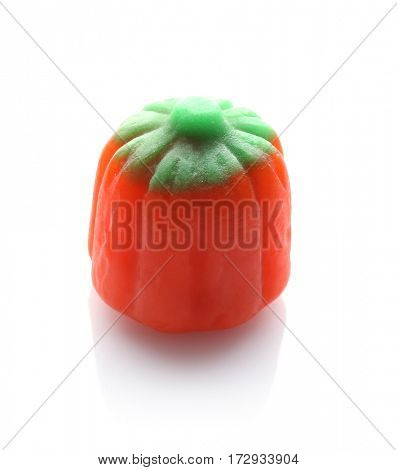 Colorful Halloween candy on white background