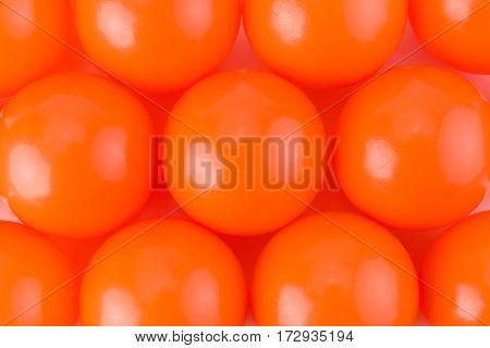 Orange Paint balls background texture studio shot